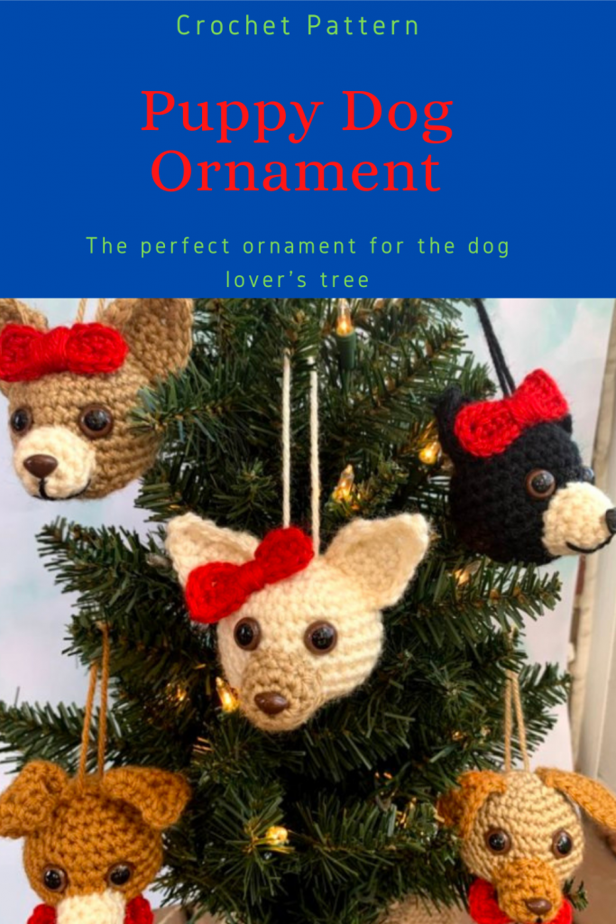 Pinterest pin showing several puppy dog ornaments hanging in a small pine tree with lights.